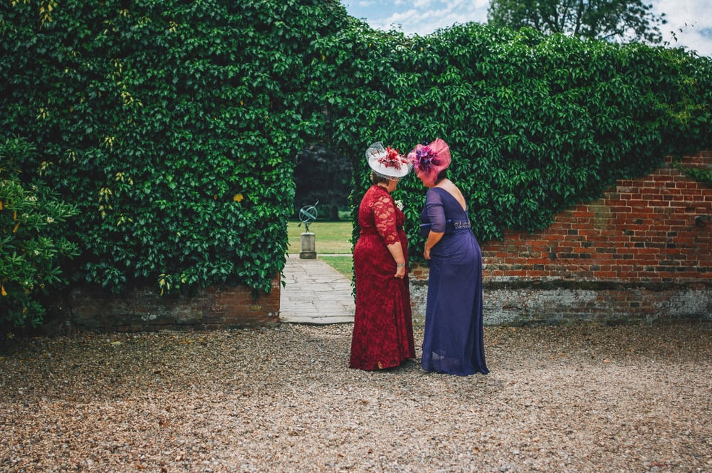 Mothers of Bride and Groom share a moment Wood Hall Suffolk Essex UK Documentary Wedding Photographer
