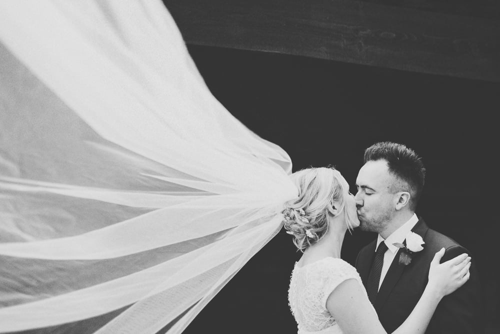 Veil in wind Bride and Groom Rustic Barn Blake Hall Essex UK Documentary Wedding Photographer