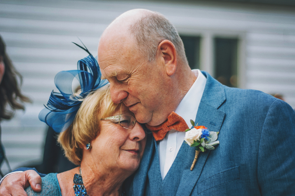 Father of bride hugs sister Cliff Barns Norfolk Essex UK Documentary Wedding Photographer