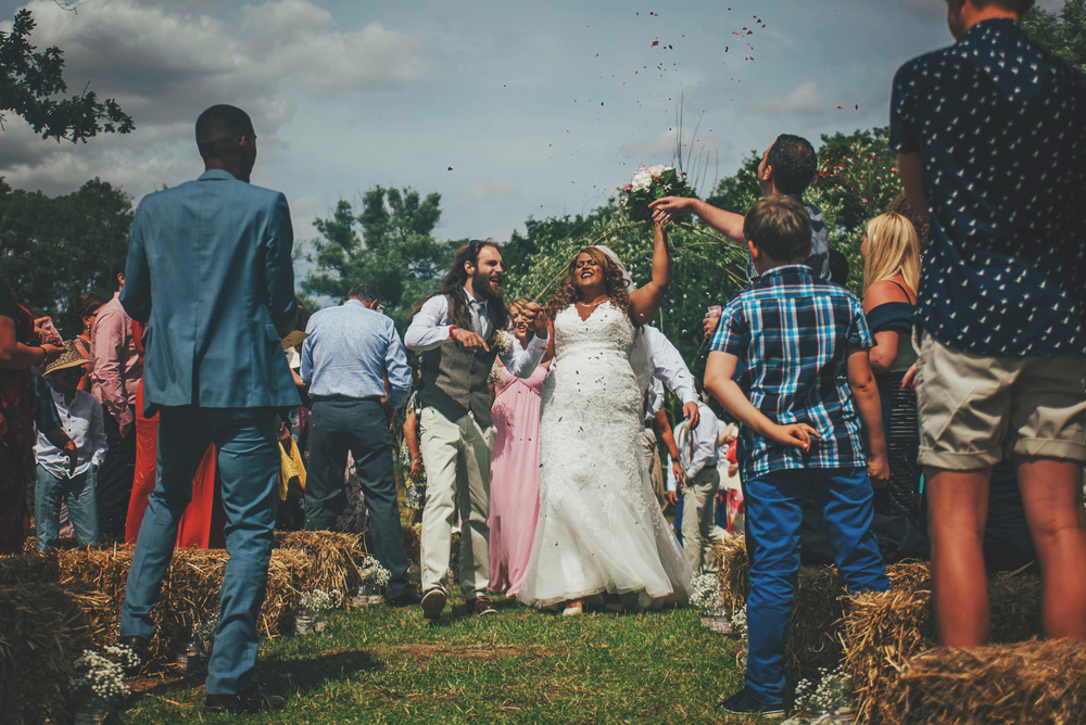 Bride Groom dance down aisle Festival Wedding Essex UK Documentary Wedding Photographer