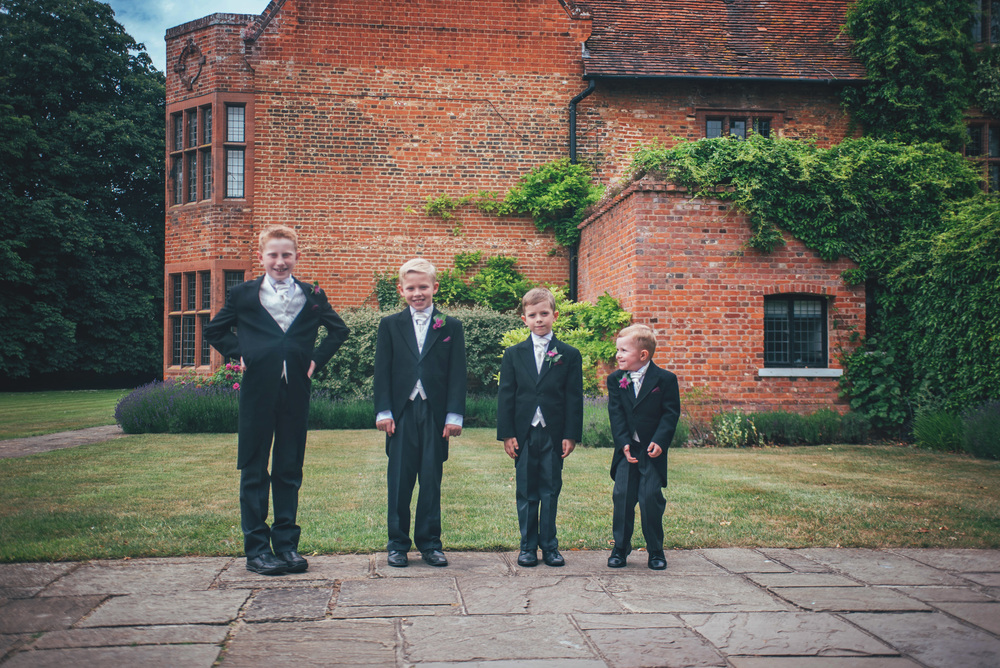 Four page boys Wood Hall Suffolk Essex UK Documentary Wedding Photographer