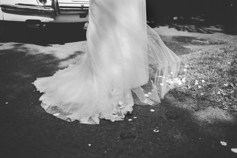 Brides dress in church yard Essex UK Documentary Wedding Photographer