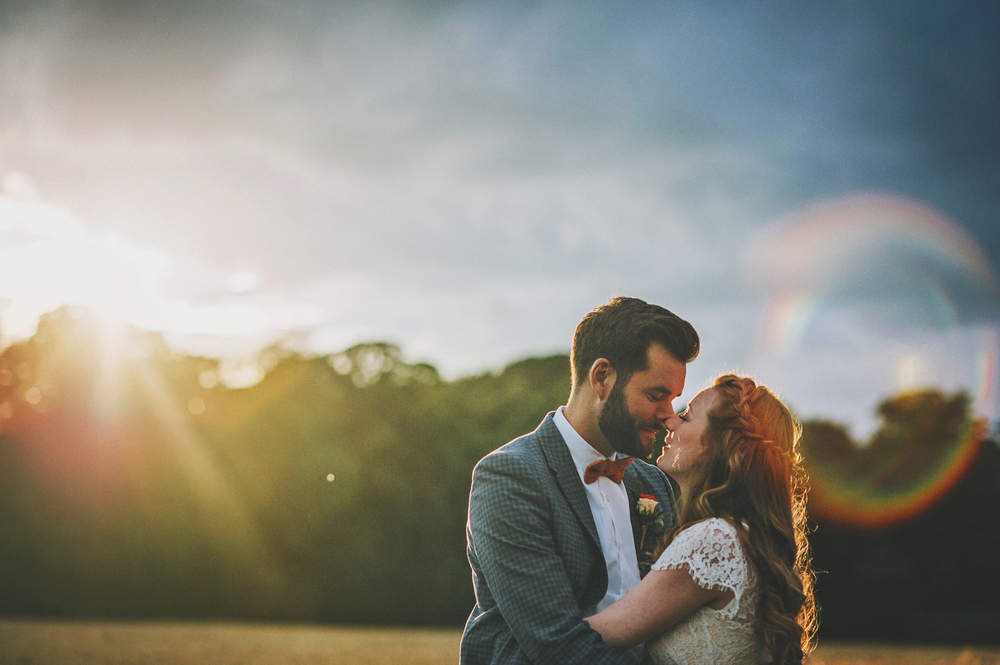 Bride Groom Bow Tie Braces Lace Sunset Cornfield Cliff Barns Norfolk Essex UK Documentary Wedding Photographer