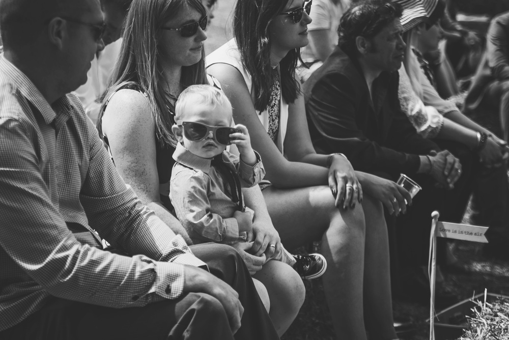 baby boy in sunglasses on haystack festival essex uk documentary wedding photographer
