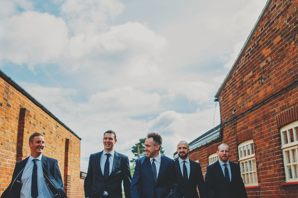 Groom and Groomsmen walking to church Blake Hall Essex UK Documentary Wedding Photographer