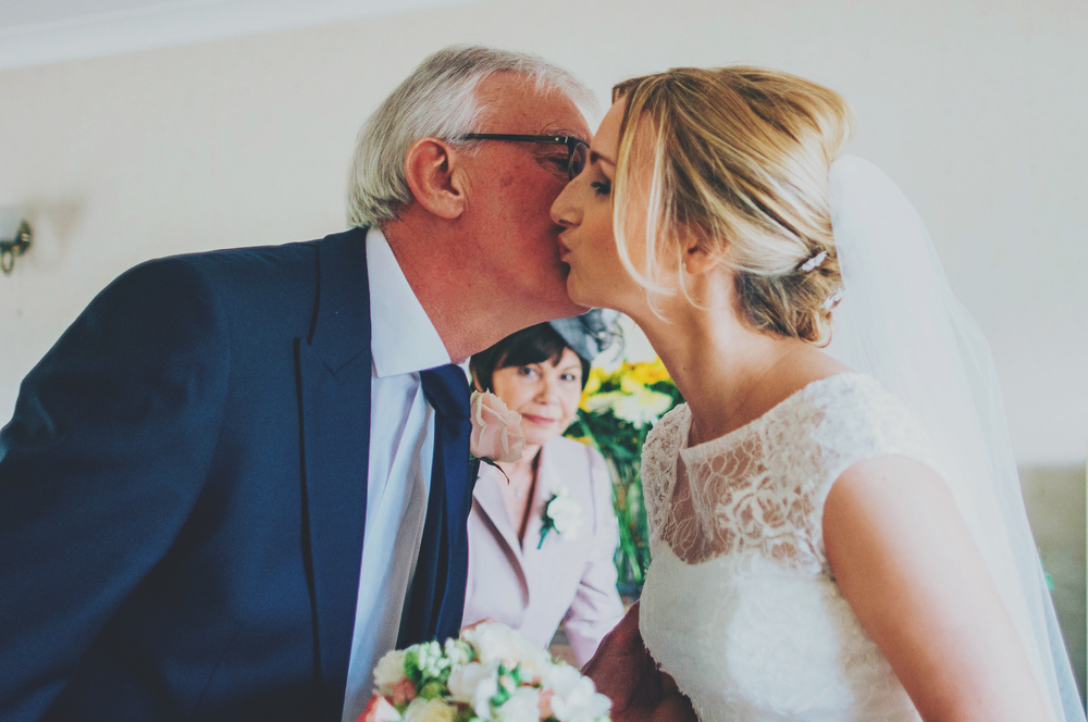 Bride kisses Dad Rustic Blake Hall Essex UK Documentary Wedding Photographer
