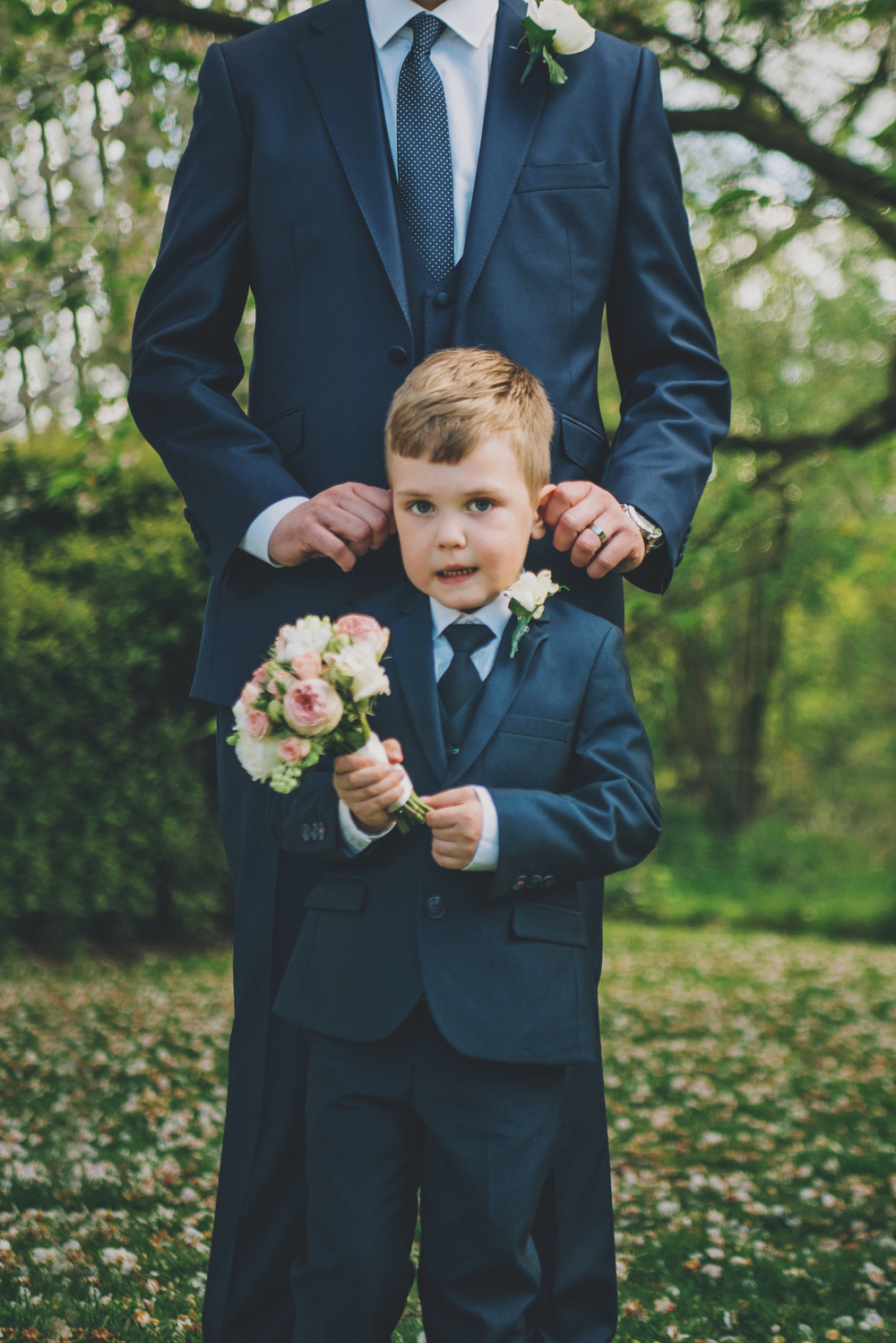 Groom pulls Page Boys ears Rustic Blake Hall Essex UK Documentary Wedding Photographer