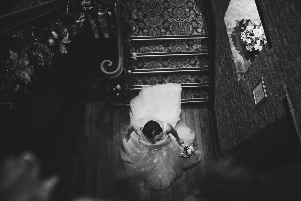Bride comes down stairs Leez Priory Essex UK Documentary Wedding Photographer
