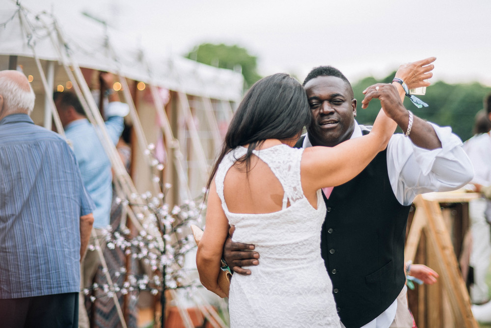 Guests dance outside Festival Wedding essex UK Documentary wedding Photographer