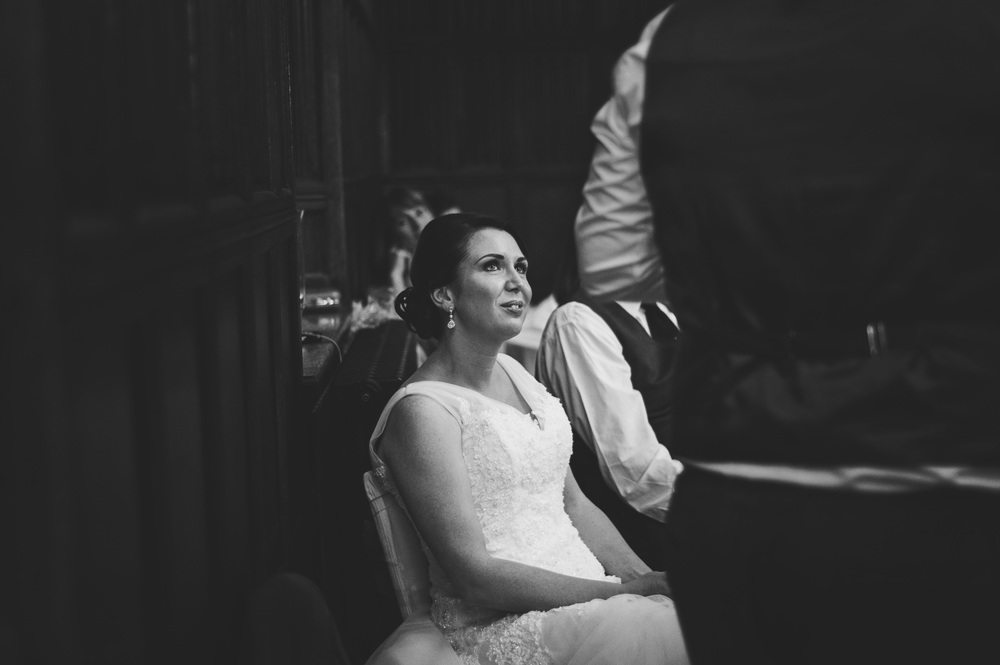 Bride watches Groom Speeches Christmas Leez priory Essex UK Documentary Wedding Photographer