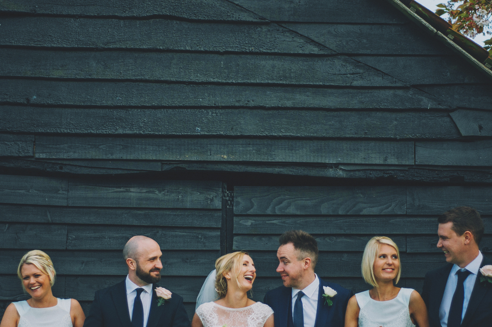 Bride Groom Bridesmaids Barn Rustic Blake Hall Essex UK Documentary Wedding photographer