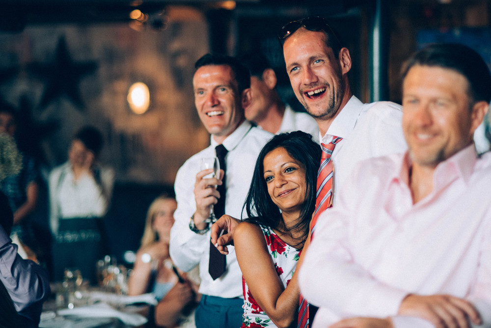 Wedding guests smile speeches London Pub Essex UK Documentary Wedding Photographer
