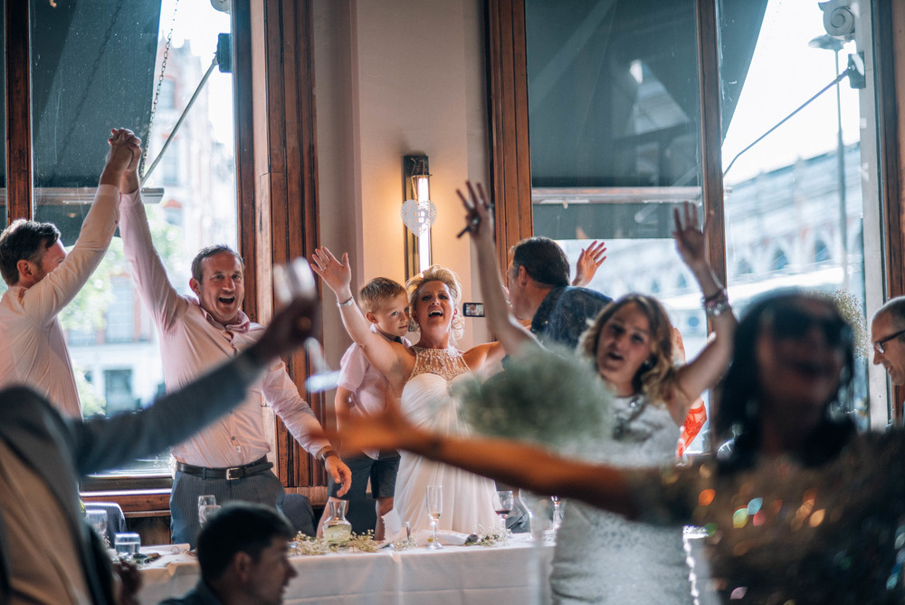 Singing Dancing Wedding Guests London Pub Essex UK Documentary Wedding Photographer
