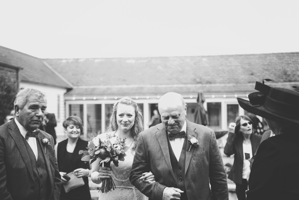 Emotional Bride with Dad walks down aisle Cliff Barns Norfolk Essex UK Documentary Wedding Photographer
