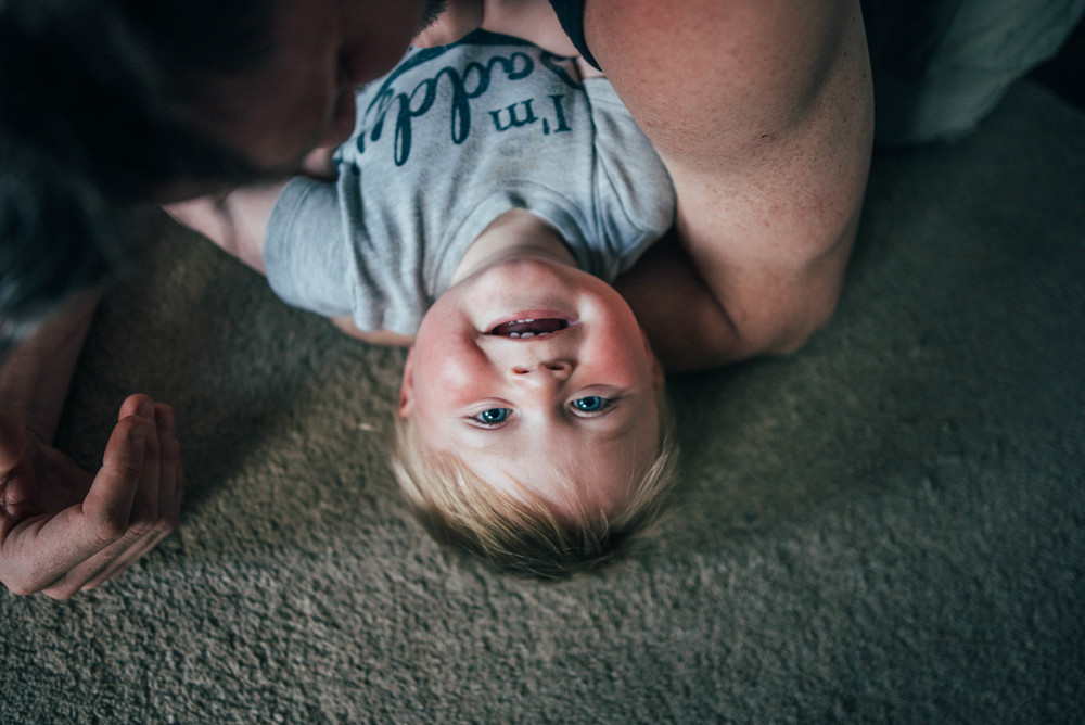 Upside Down baby boy smiling Essex UK Documentary Portrait and Lifestyle Photographer