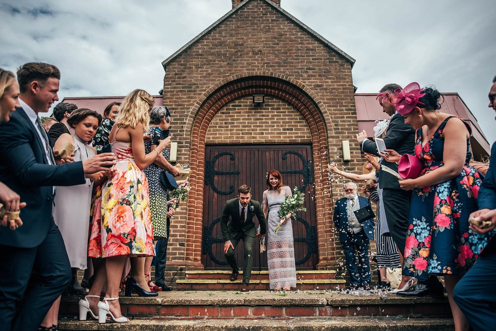 Bride in Lilac dress for Vintage DIY Hutton Poplar Village Hall Essex UK Documentary Wedding Photographer