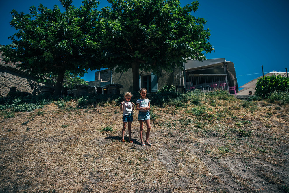 Two girls inside the walls of Citadel Carcassonne France Essex UK Documentary Photographer