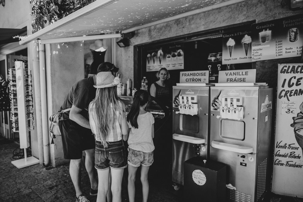 Dad buys ice cream for daughters Citadel Carcassonne France Essex UK Documentary Portrait Photographer