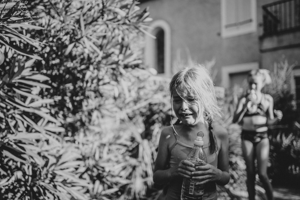 Little girl upset in garden Essex UK Documentary Portrait Photographer