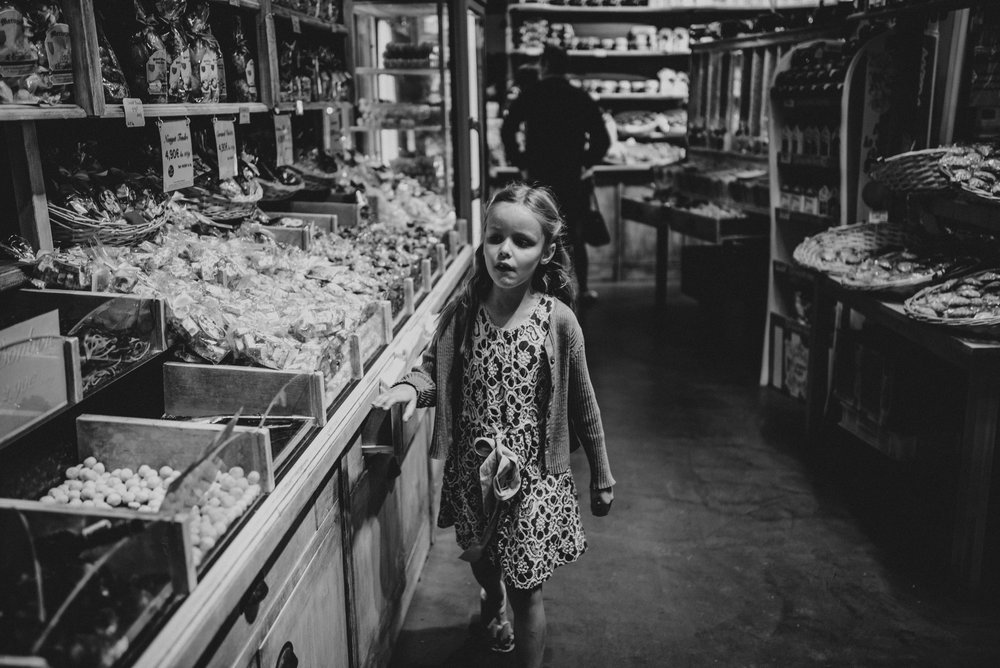 Young girl in sweet shop Essex UK Documentary Portrait Photographer