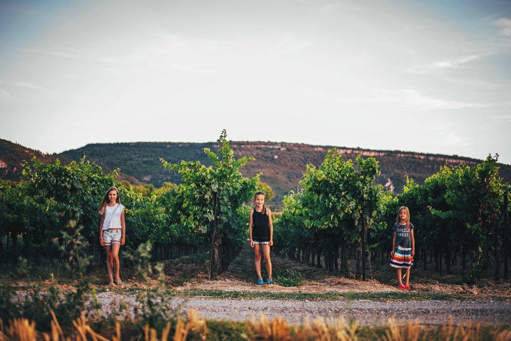 Three girls in vineyard Essex UK Documentary Portrait Photographer