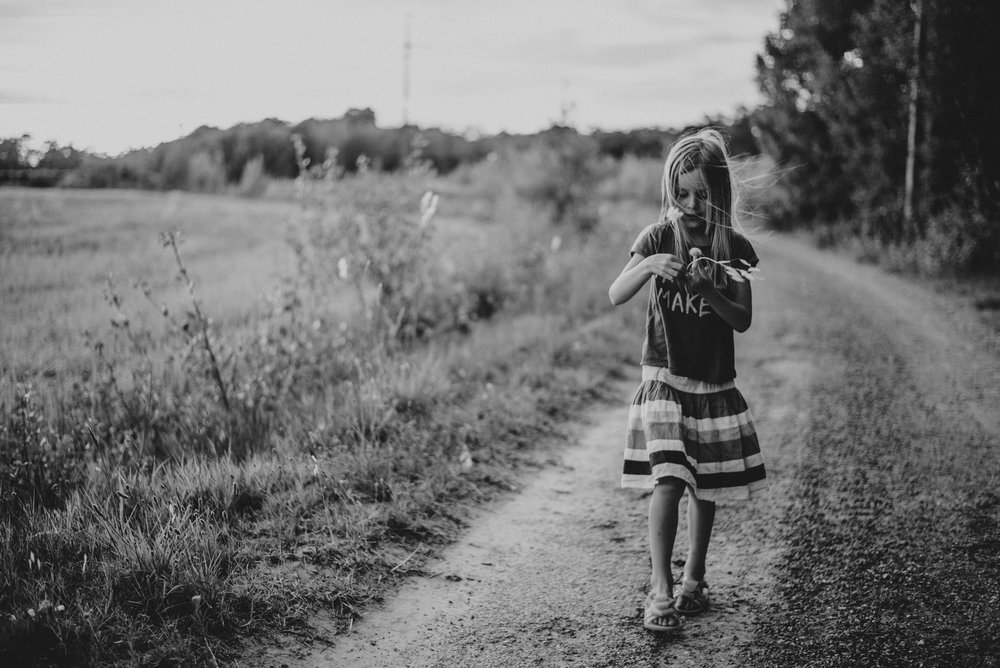 Young girl walks down country land Essex UK Documentary Portrait Photographer