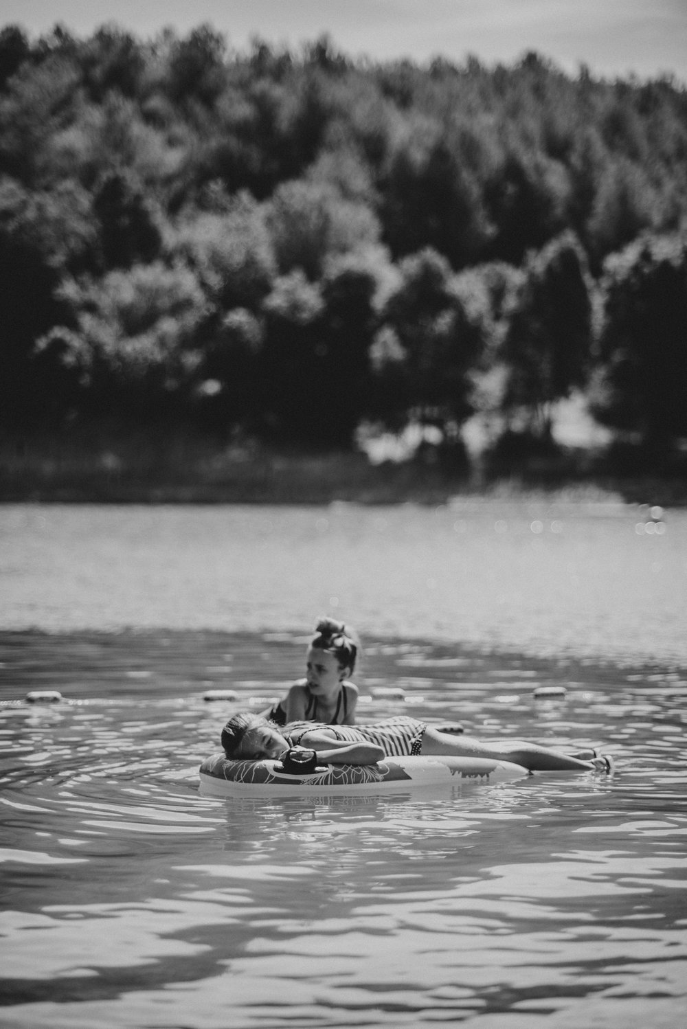 Little girl in boat on lake Essex UK Documentary Portrait Photographer