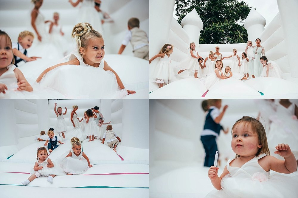 Bride Groom Essex Wedding Photographer Documentary Blake Hall Bouncy Castle Fun