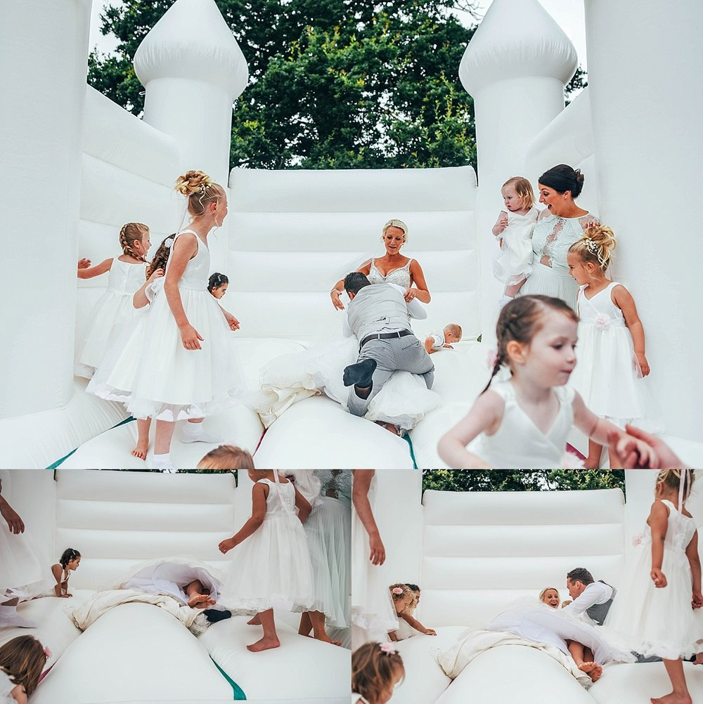 Bride Groom Essex Wedding Photographer Documentary Blake Hall Bouncy Castle