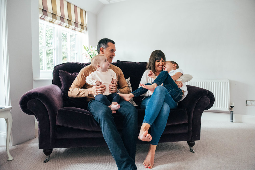 Family Lifestyle Shoot At home Family laugh on sofa Essex UK Documentary Portrait Photographer