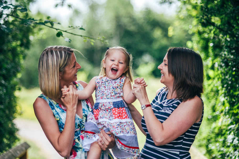 Little girl laughs with Mum and Aunt Lifestyle Shoot Essex UK Documentary Portrait Photographer