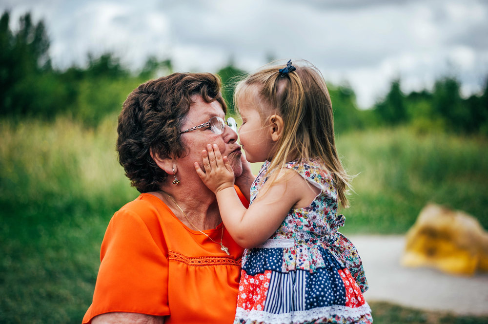 Little girl kisses Grandma Lifestyle Shoot Essex UK Documentary Portrait Photographer