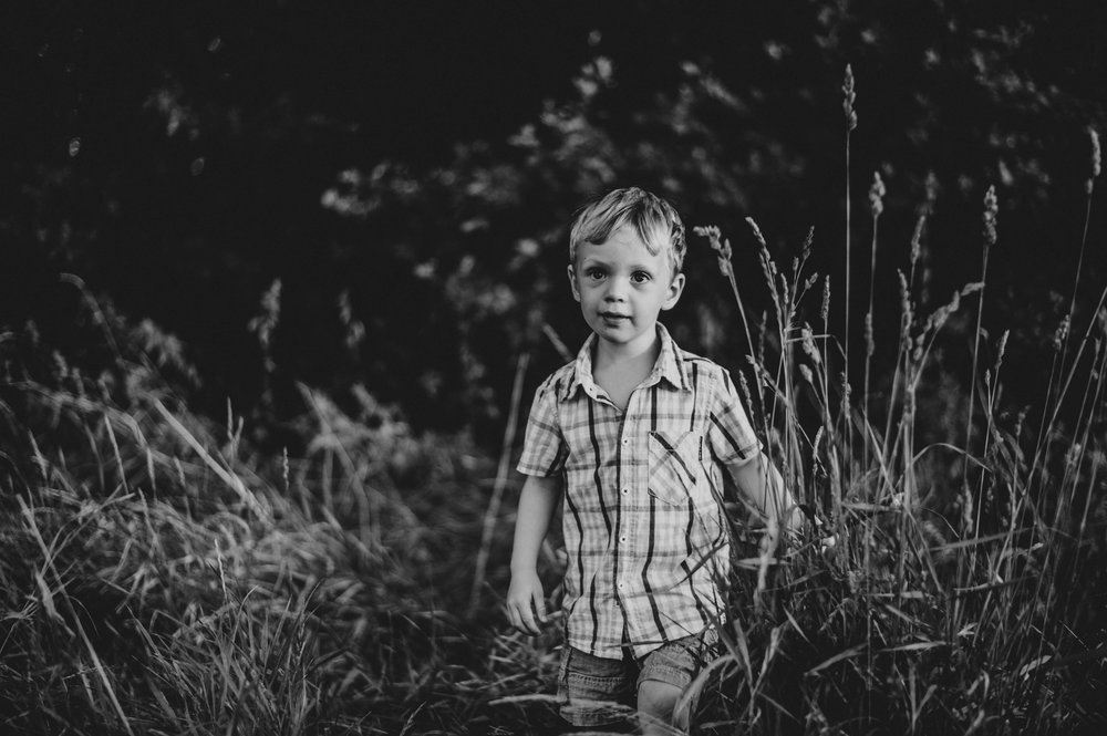 Little boy in long grass Summer Evening Essex UK Documentary Portrait Photographer