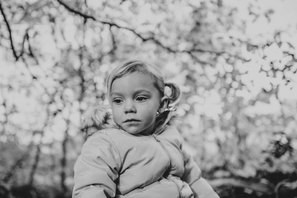 Little Girl with trees above Lifestyle Shoot Essex UK Documentary Portrait Photographer