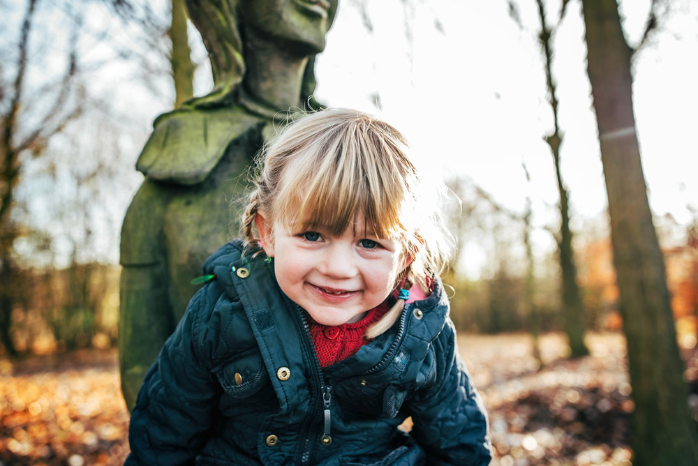 Little girl looks into camera with Autumn light Lifestyle Shoot Essex UK Documentary Portrait Photographer