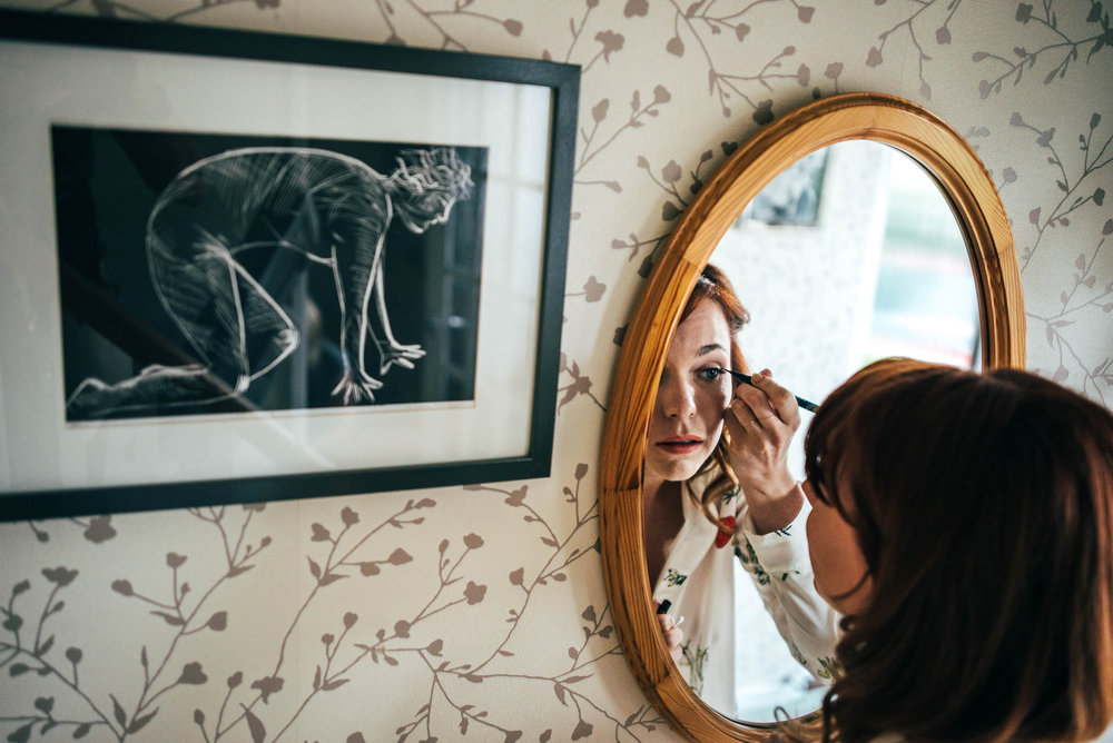 Bride checks make up Hutton Poplar Village Hall diy vintage lilac dress wedding Essex UK Documentary Photographer