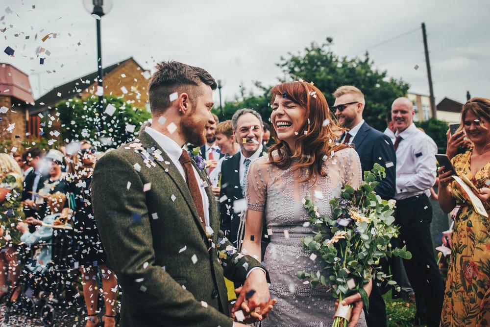 Bride & Groom confetti Lilac Vintage Dress Hutton Poplar Village Hall DIY Wedding Essex UK Documentary Photographer