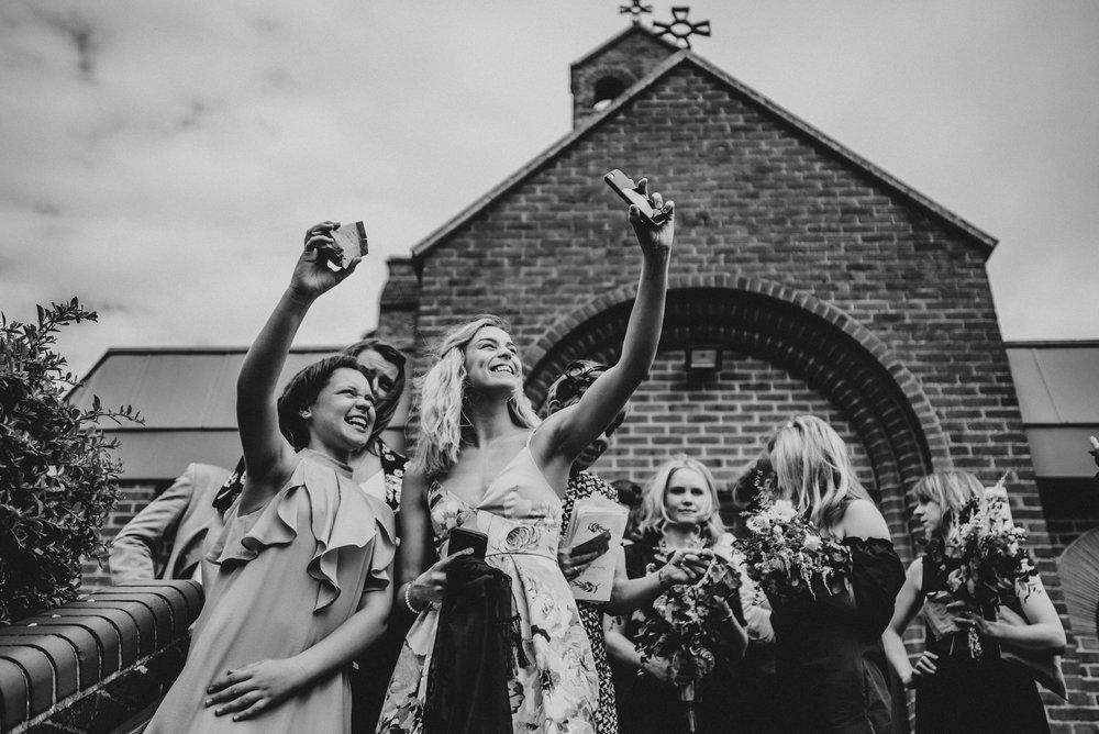 Wedding guest take selfies vintage diy Poplars Hutton Village Hall Wedding Essex UK Documentary Photographer