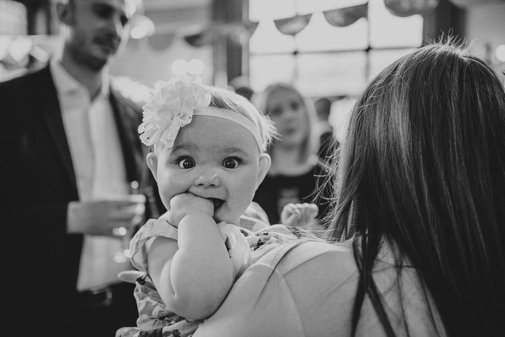 Baby Girl at Hutton Poplars Village Hall Wedding DIY Vintage Essex UK Documentary Photographer
