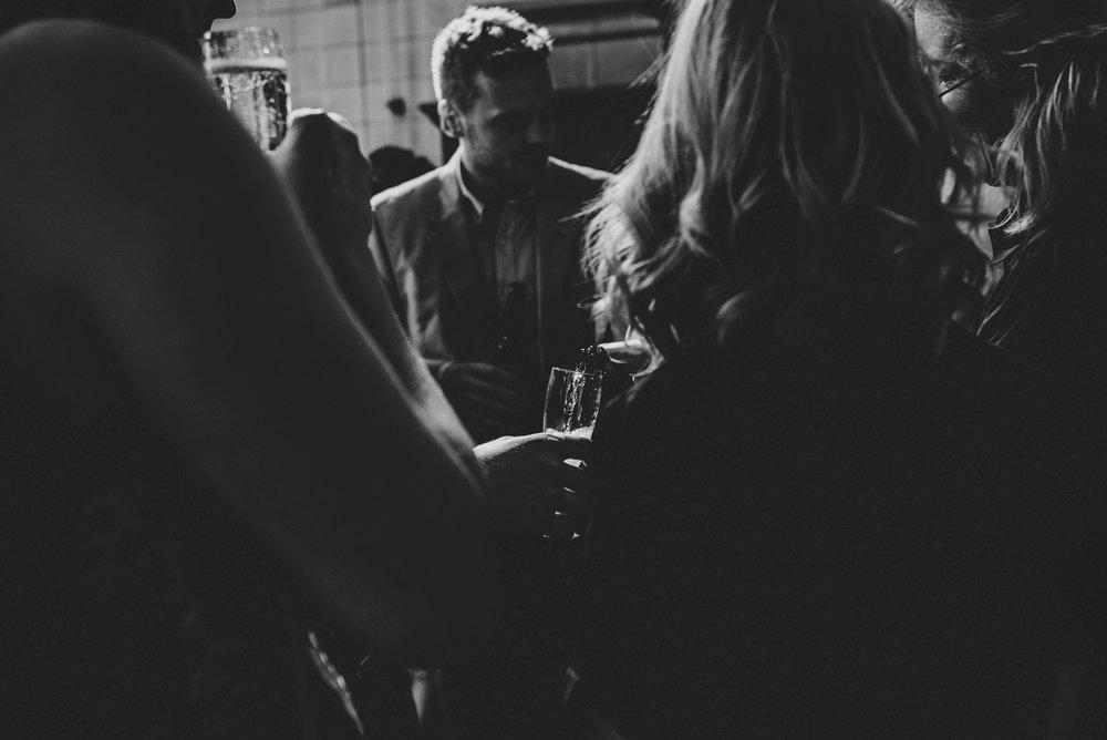 Champagne at Hutton Poplars Village Hall DIY Wedding Essex UK Documentary Photographer