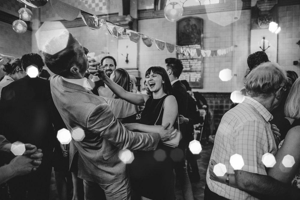 Guests on dance floor vintage diy Hutton Poplars Village Hall Wedding Essex UK Documentary Photographer