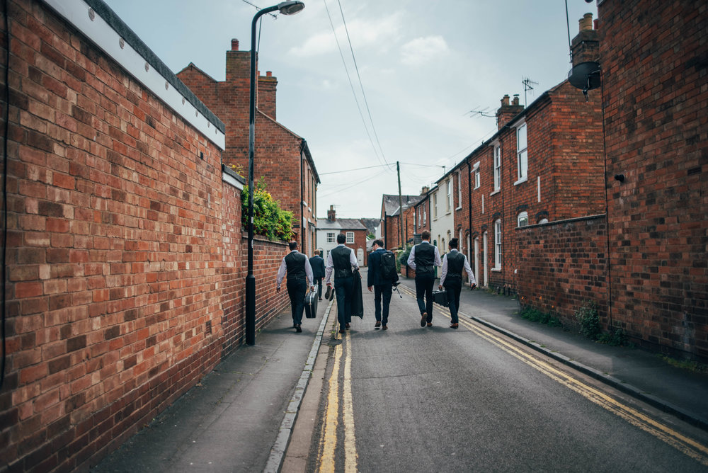 Groom and Groomsmen walk to Stratford Upon Avon Town Hall Wedding Tipi Essex UK Documentary Photographer