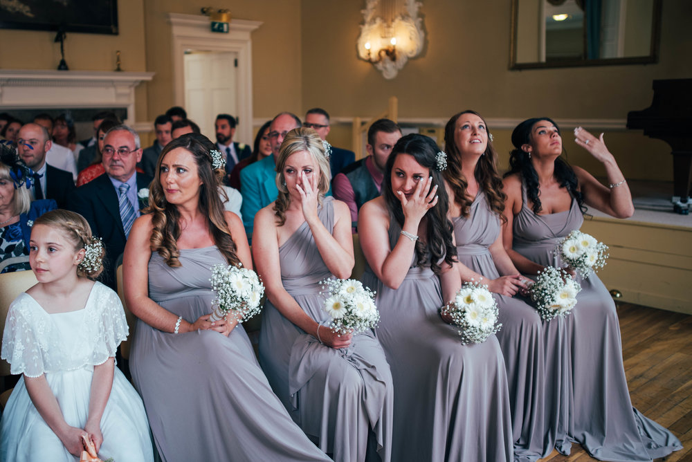 Emotional Bridesmaids at Tipi Wedding Stratford Upon Avon Town Hall Essex UK Documentary Photographer