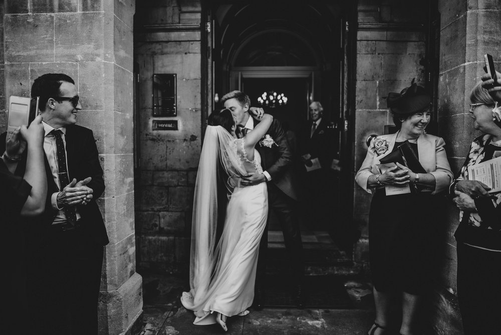 Bride Groom kiss outside Stratford Upon Avon Town Hall Tipi Wedding Essex UK Documentary Photographer