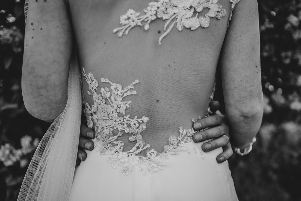 Detail on Brides Willowby Dress Stratford Upon Avon Town hall Tipi Essex UK Documentary Wedding Photographer