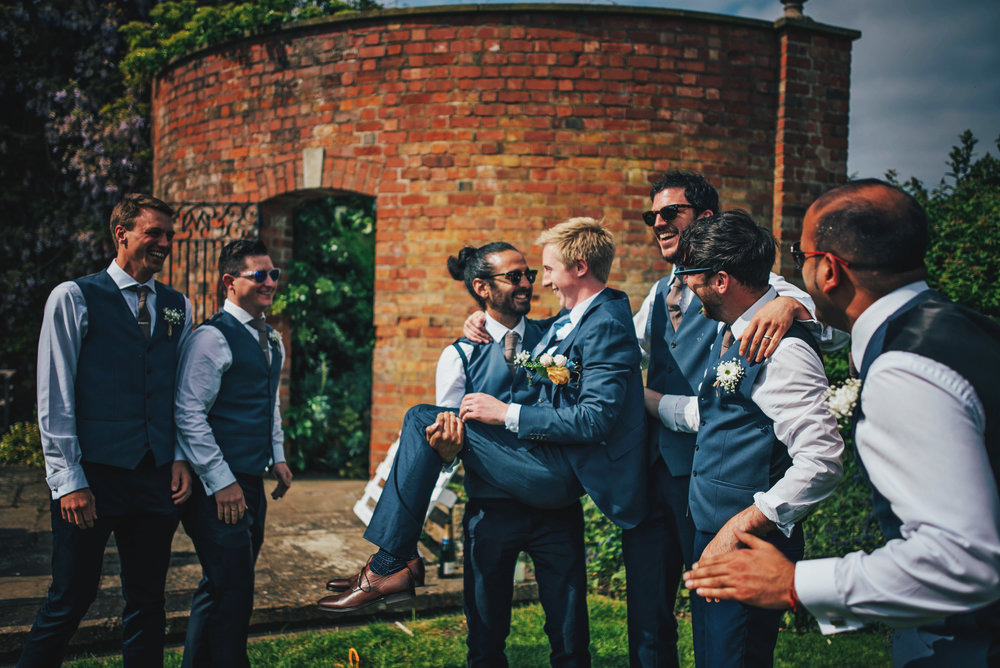 Groomsman picks up Groom at Stratford Upon Avon Town Hall Tipi Wedding Essex UK Documentary Photographer