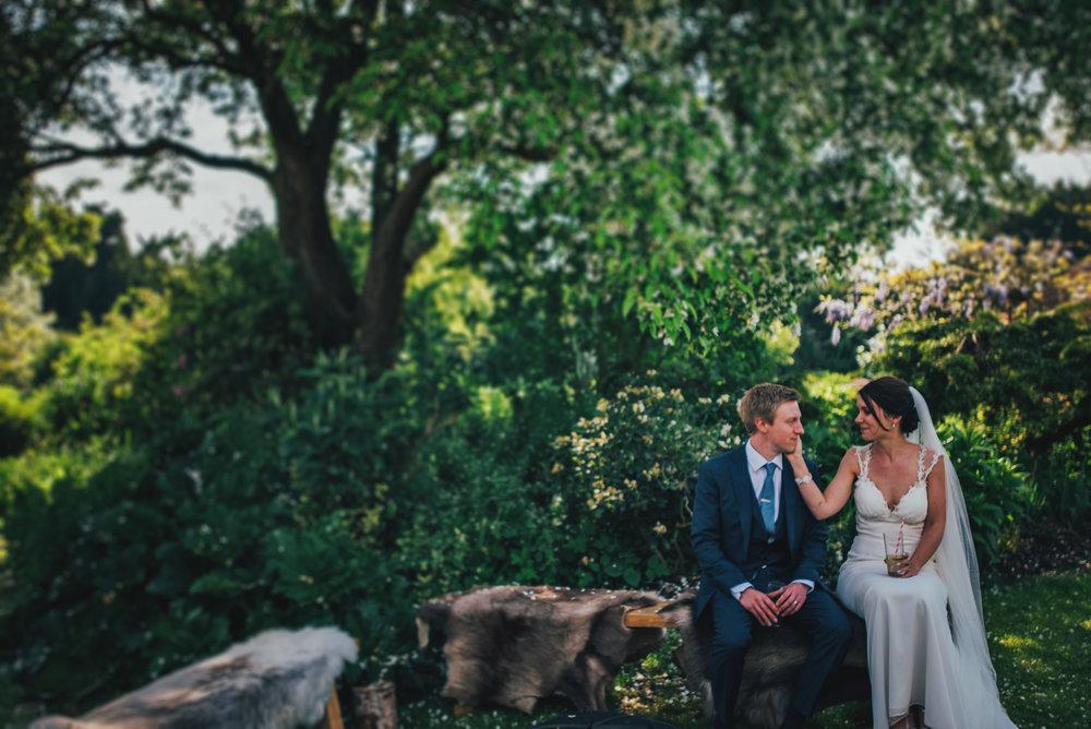 Bride & Groom share tender moment at Tipi Wedding Stratford Upon Avon Essex UK Documentary Photographer