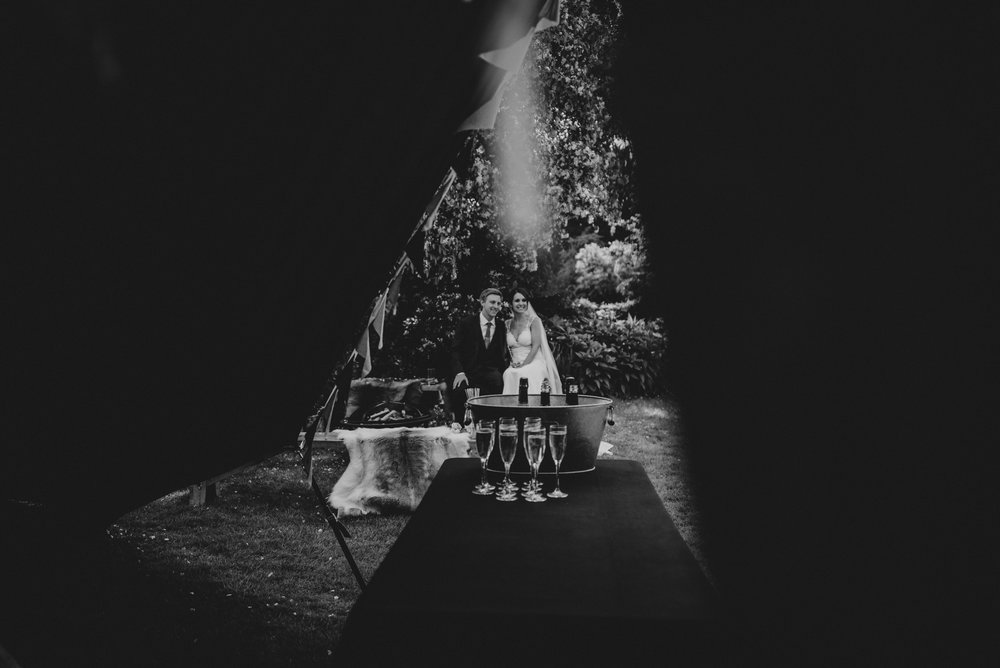 Bride & Groom outside Tipi Stratford Upon Avon Town Hall Wedding Essex UK Documentary Photographer