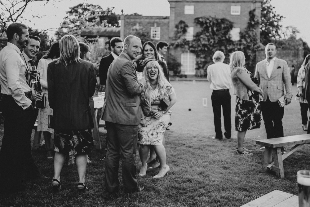Laughing guests Stratford Upon Avon Town Hall Tipi Wedding Essex UK Documentary Wedding Photographer