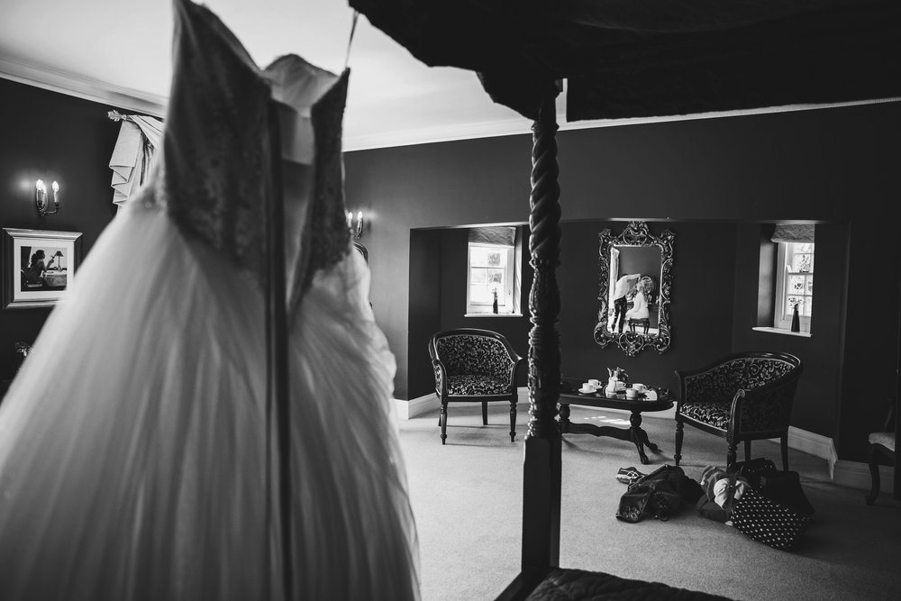 Brides reflection in mirror at Parklands Quendon Hall Essex UK Documentary Photographer